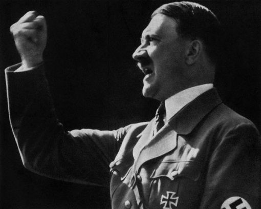 ca. 1939, Germany --- Adolf Hitler raises a defiant, clenched fist during a speech. --- Image by © Bettmann/CORBIS