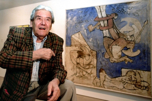 """(FILES) This file photo dated 20 January 1999 shows Chilean-born French painter Roberto Matta explaining some details of his painting """"I piedi del mondo"""" during an exhibition in Barcelona. Roberto Matta, considered as one of the world's most important surrealist painters, died at the age of 91, 23 November 2002 in Civitavecchia, near Rome.   AFP PHOTO/JULIAN MARTIN"""